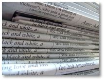 a-stack-of-newspapers
